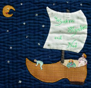 Embroidered sleep quilt with Land of Nod theme.